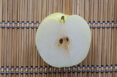 Chinese pear on mat. One chinese pear on japanese style mat Royalty Free Stock Photo