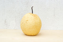 Chinese pear still life on concrete wall and plywood background. Picture royalty free stock image