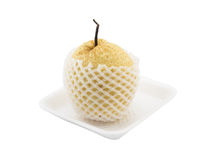 Chinese pear with white net protection on foam tray isolated whi Royalty Free Stock Photo