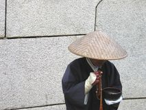 Chinese peasant. A street performer dressed in traditional Chinese/Japanese peasant costume around the protective walls of Osaka Castle, Japan Stock Photos