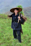 Chinese peasant shepherd wearing cloak an animal skin, rural Chi Stock Photo