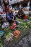 Chinese peasant women selling farm products at  village market, Royalty Free Stock Photography