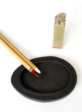 Chinese pen on ink stone royalty free stock photo