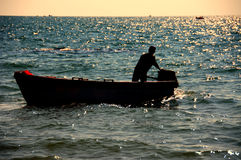 Chinese peope driving boat on the sea Royalty Free Stock Images