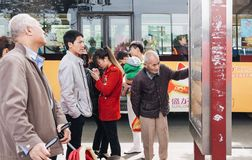 Chinese people on a bus stop in Xian, China Stock Photos