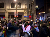 Chinese people celebrate new year. Chinese people celebrate the coming new year on the last day of 2013, people are walking on East Nanjing Street,and sticked by Royalty Free Stock Image