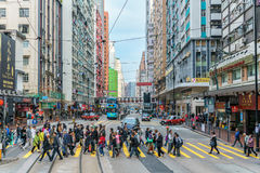 Chinese people crossing tramway street on Hong Kong Island Stock Photography