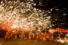 Chinese people dance dragon with hotting iron flow Stock Photos