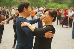 Chinese people dance in Jingshan Park in Beijing, China. Stock Photos