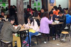 Chinese people enjoy the food in a restaurant in Xian, China Royalty Free Stock Images