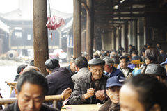 Chinese people enjoying afternoon in teahouse Royalty Free Stock Image