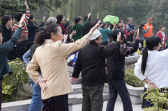 Chinese People Exercise Tai Chi, Xian China Travel. Scene of Chinese people exercising with Tai Chi in Xingqing Park located in Xian, China. Travelers and royalty free stock photo