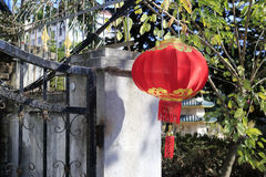 Chinese people hanging red lanterns Royalty Free Stock Image