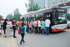 Chinese people line up on the bus stock photos