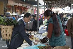 Chinese people in a local market in Xizhou close to Dali Old Town in Yunnan royalty free stock photography
