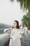 Chinese People Practicing Tai Ji, Hands in Circle, Outdoors Royalty Free Stock Photos