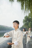 Chinese People Practicing Tai Ji, Hands in Circle, Outdoors Royalty Free Stock Image