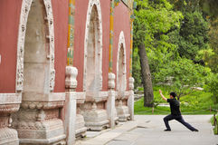 Chinese People Practicing Tai Ji by the memorial archway, Beijing Royalty Free Stock Photo