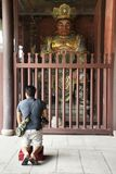Chinese people praying Chinese angel warrior door keeper statue at gate of Tiantan temple at Shantou town or Swatow city. For people visit and respect praying stock images