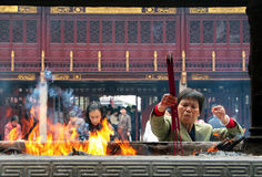 Chinese people praying in City God Temple Chenghuang Miao Royalty Free Stock Images