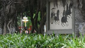 Chinese people relaxing in garden at Zhongshan Park. GUANGDONG, CHINA - MAY 9 : Chinese people relaxing in garden at Zhongshan Park in Shantou city or Swatow stock video footage