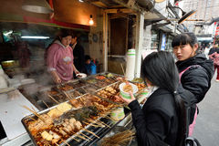 Chinese people trades traditional food Stock Images