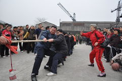 Chinese people are tug-of-war. Chinese people pulling rope in tug-of-war at the stadium Royalty Free Stock Photography