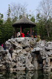 Chinese people under a gazebo at Guyi Gardens Stock Image