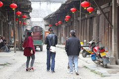 People and red lampions in ancient Chinese village Royalty Free Stock Photos