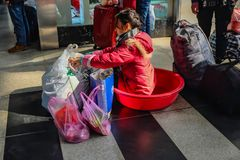 Chinese people wait for the rocket train to go to another city in Yiwu Train station royalty free stock photography