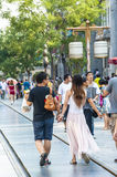 Chinese people walking on the street Royalty Free Stock Photos
