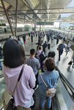 Travelers with masks boarding train, Wuxi, China