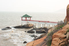 Chinese pergola on the sea coast in Macao Stock Photography