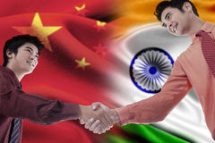 Chinese person handshakes with indian person Royalty Free Stock Photos