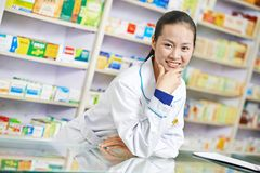 Chinese pharmacy chemist woman in china drugstore Royalty Free Stock Images