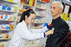 Chinese pharmacy woman with patient Stock Image