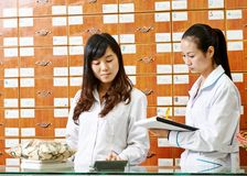 Chinese pharmacy worker in china drugstore Stock Images