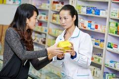 Chinese pharmacy worker in china drugstore Stock Image