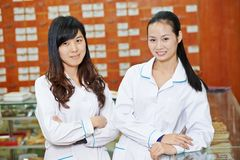 Chinese pharmacy worker in china drugstore Royalty Free Stock Photos