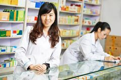 Chinese pharmacy worker in china drugstore Royalty Free Stock Photo