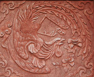 Chinese phoenix. Ancient design of chinese phoenix on the wall royalty free stock photo