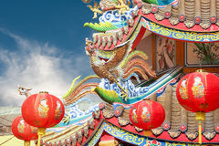 Chinese phoenix on temple roof. Chinese phoenix with lanterns on temple roof stock photo