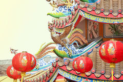 Chinese phoenix on temple roof. Chinese phoenix with lanterns on temple roof royalty free stock image