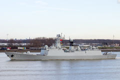 Chinese PLA Navy. ROTTERDAM - JAN 30, 2015: Chinese PLA Navy multi-role frigate Yuncheng (571) is leaving the Port of Rotterdam after the first visit ever of the Stock Photos