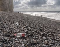 Chinese plastic bottle blown onto the rocky beach at Birling Gap, Sussex stock photos