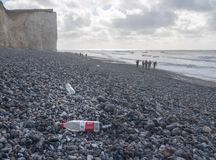 Chinese plastic bottle blown onto the rocky beach at Birling Gap, Sussex royalty free stock photo