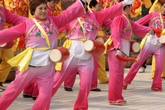 Chinese play drum and beat gong. Some Chinese  get together to play drum and beat gong in adragon dance party to celebrate the lantern festival ,a boy sit on the Stock Image