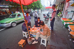 Chinese playing game on the street Stock Image