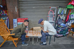 Chinese playing a game on the street Royalty Free Stock Photography
