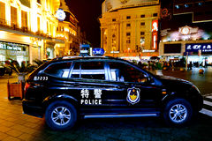 Chinese police car guarding Nanjing Road in Shanghai, China Royalty Free Stock Image